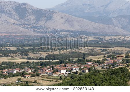 View of the mountain village and arable land on a sunny day (Macedonia, northwest Greece)