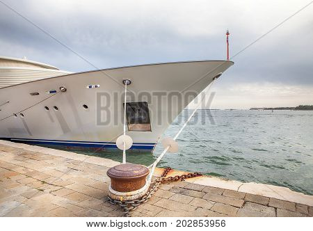 moored yacht with rope on the quay