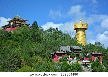 Beautiful view of theTibetian temple and the biggest buddhist wheel in the world. Shangri-La Yunnan province China.