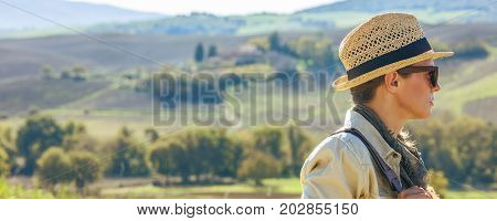 Adventure Woman Hiker Hiking In Tuscany Looking Into Distance