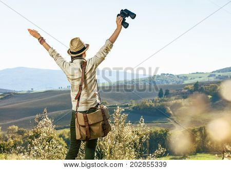 Woman Hiker Hiking In Tuscany With Binoculars Rejoicing