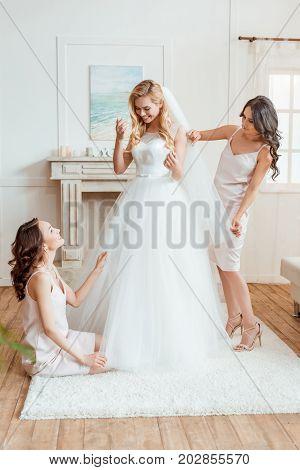 Bride With Bridesmaids Preparing For Ceremony