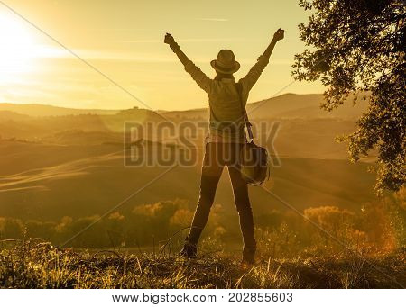 Woman Hiker Enjoying Sunset In Tuscany And Rejoicing