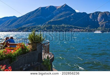 Bellagio Italy - August 31 2010: A young couple on the Como llake front