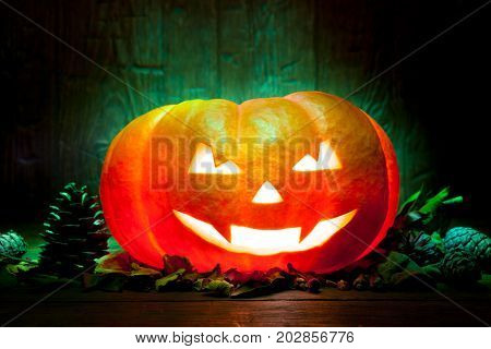Scary Halloween Pumpkin On A Green Wooden Background
