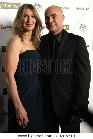 HOLLYWOOD - JAN. 22: Andre Agassi & Steffi Graf arrive at the 2011 G'Day USA Los Angeles Gala  on January 22, 2011 in Hollywood, CA