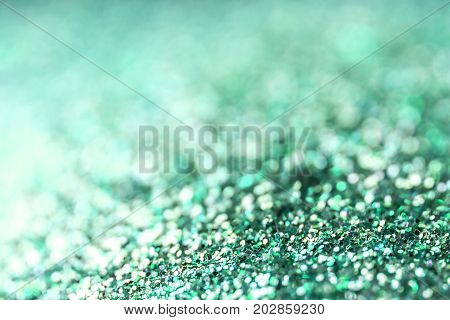 Green Festive Christmas background. Abstract twinkled bright background with bokeh defocused lights