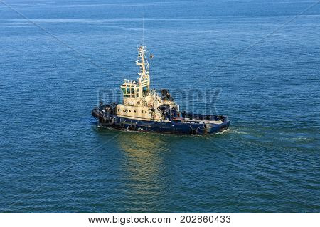 A working tugboat off the coast of Lisbon Portugal