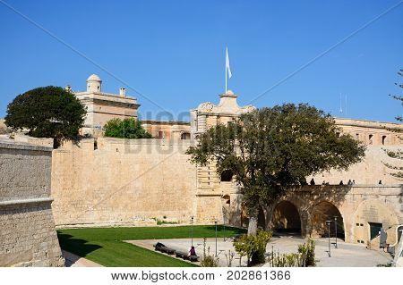 MDINA, MALTA - MARCH 29, 2017 - Footbridge leading to the Town Gate and city centre Mdina Malta Europe, March 29 2017.
