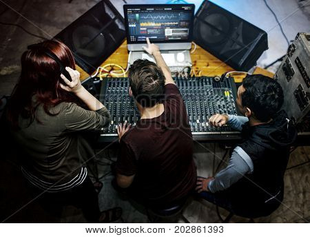 People at a sound mixer station