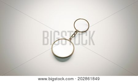 Blank gold round white key chain mockup isometric view 3d rendering. Clear golden circular keychain design mock up isolated. Empty plain keyring souvenir holder template. Steel circle trinket label