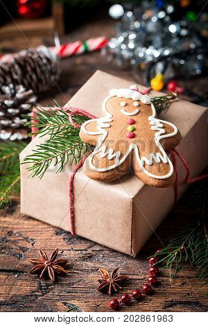 Christmas Decorations with Gingerbread man, gift boxes and christmas baubles