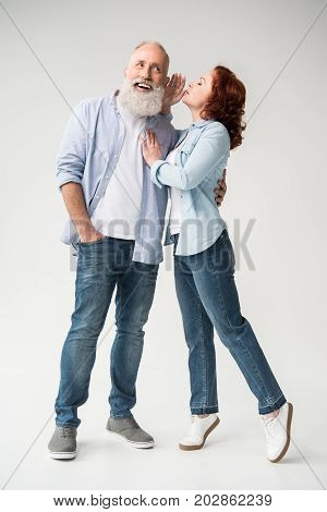 Woman Whispering To Her Husband