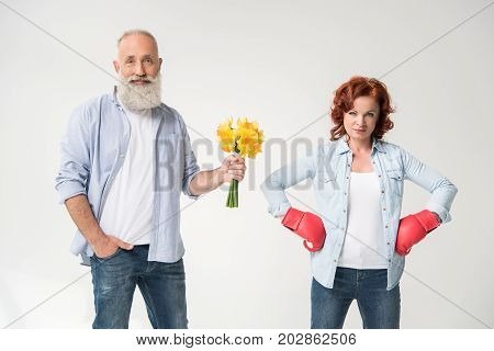 Woman In Boxing Gloves And Husband With Bouquet