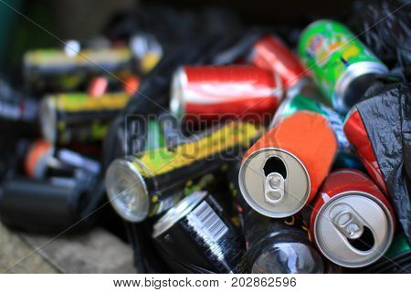 Colorful aluminum cans all together for recycling metal waste to help polution on Earth and to be environmentally friendly