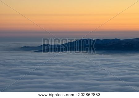 Foggy View From Jested Mountain Peak. Cold Winter Day. Liberec, Czech Republic.