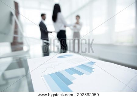 Blurred image of the desktop in the office. business background.