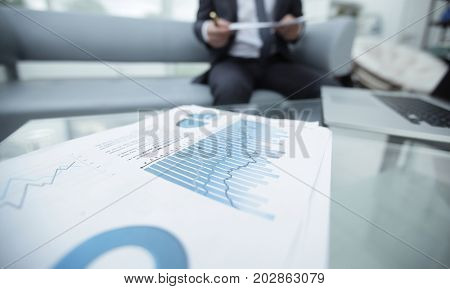 financial graph on the desktop. business background.