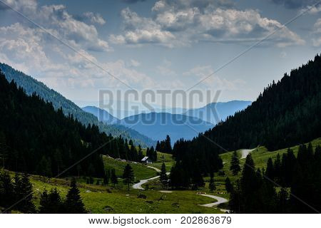 a way in the mountains with a small hut