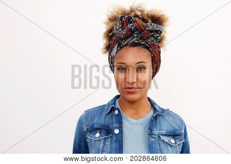 Young Black Woman In Headscarf Standing Against White Background