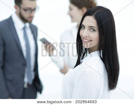 close-up of a beautiful woman manager and co-workers in the office