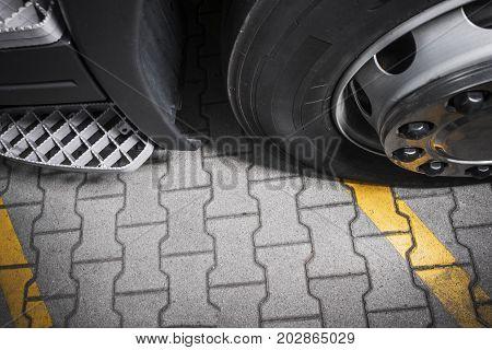 Heavy Duty Brick Pavement. Semi Truck Wheel on the Brick Closeup Photo.