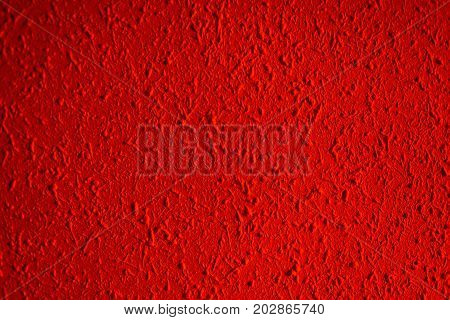 Closeup of red color grunge textured wall with vignetting may use as background with copy space for text