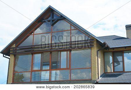 Attic skylight window wall. Modern house with panoramic window balcony skylight.
