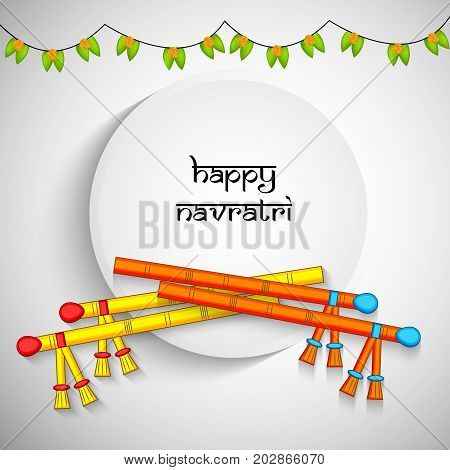 illustration of dandiya sticks and decoration with Happy Navratri text on the occasion of hindu festival Navratri