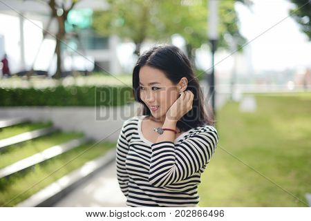 Beautiful Smiling Thai Woman With Casual Dress With Copy Space For Text