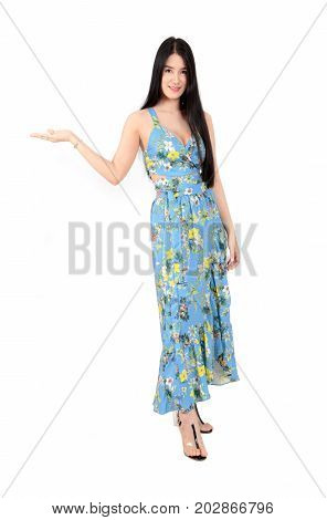 Young Woman In Summer Dress With Hand Presenting Something, Full Body Shot