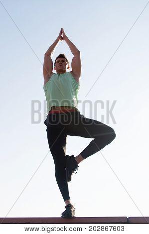 Bodybuilder Man In Tracksuit Posing On Sunny Day