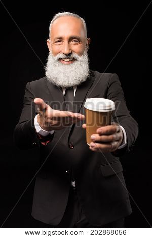 Businessman Pointing At Coffee Cup