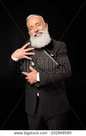 Businessman Embracing Briefcase