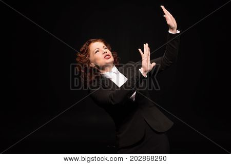 Businesswoman Pretending To Shelter From Danger