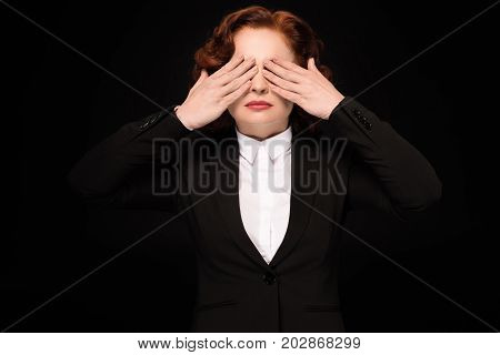 Businesswoman Covering Eyes