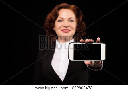 Businesswoman Showing Smartphone Screen