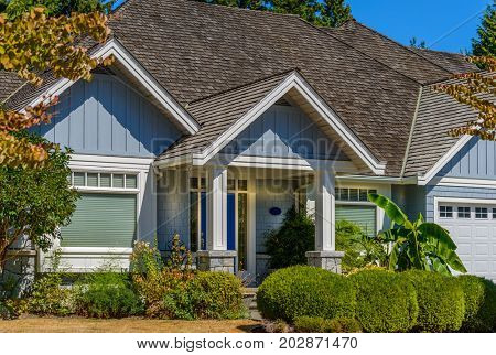 A perfect neighborhood. Houses in suburb at Fall in the north America. Fragment of a luxury house with nice window.
