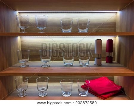 Kitchen Shelf With Empty Glasses And Backlight