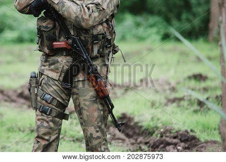 Close Up On Soldier With Machine Gun