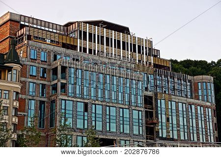 Construction of a large multi-storey building with many windows