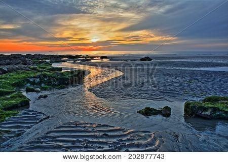 The sunset at Ambleteuse beach near Wimereux, Cote d'Opale, Pas de Calais, Hauts de France, France