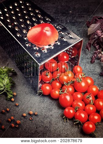 Preparation Recipe Tomato Juice. Large Tomato And Old Grater Down To Small Grape Cherry Tomatoes On