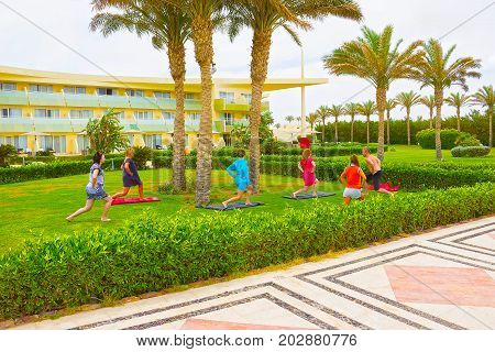 Sharm el Sheikh -April 14, 2017: Tourists doing the animation yoga at Barcelo Tiran Sharm Hotel 5 at Sharm el Sheikh on April 14, 2017