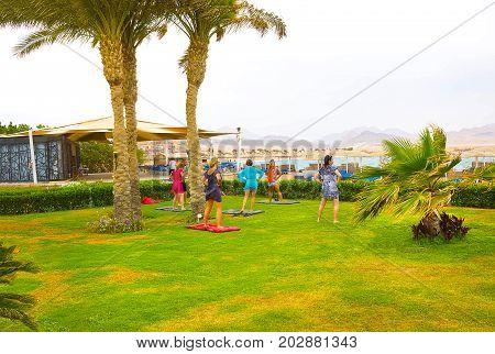 Sharm el Sheikh -April 14, 2017: Tourists doing the animation yoga at Barcelo Tiran Sharm Hotel 5 at Sharm el Sheikh on April 14, 2017