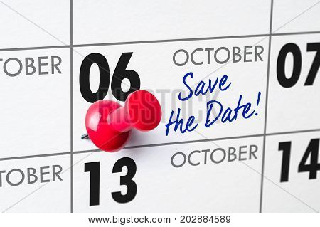 Wall Calendar With A Red Pin - October 06