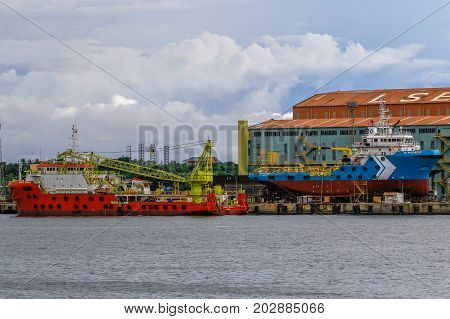 Labuan,Malaysia-Aug 30,2017:Ships on maintenance in the shipyard at Labuan,Malaysia.The ship repair industry in Malaysia involves repairing & maintaining of vessels as well as marine equipment.