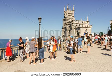 Yalta, Crimea - 11 July, Visitors on the site at the castle, 11 July, 2017. Small Castle Lastochkino Nest and its surroundings.