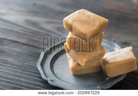 Maple cream fudge on the wooden table