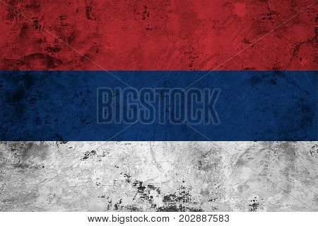 Flag of the Serbia against the background of the stone texture